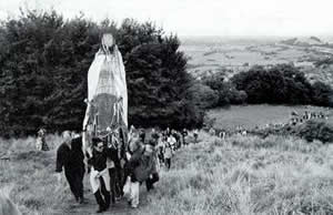 The Crone Goddess from the 1999 Goddess Conference joins 2,000 pilgrims climbing the Tor to view the solar eclipse