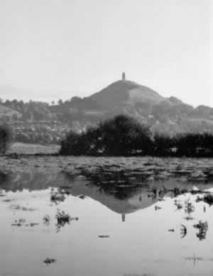 Tor reflected in floodwater