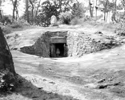 Neolithic ritual mound or passage grave aligned ESE and surrounded by a ring of stones at Kercado in Brittany dating from 4675BCE